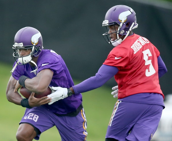 Teddy Bridgewater and Adrian Peterson during the June minicamp at Winter Park.