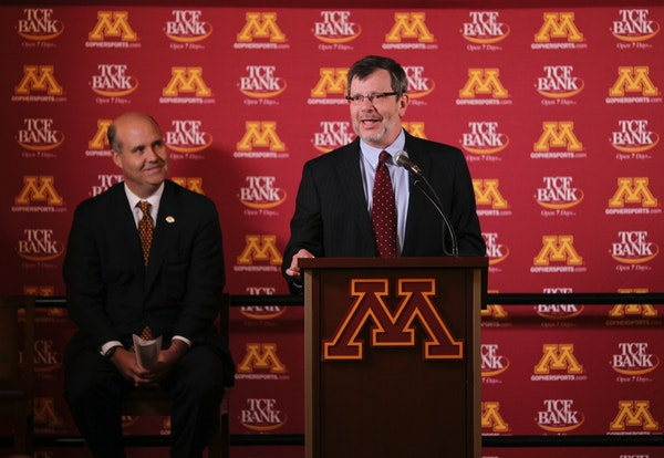 University of Minnesota President Eric Kaler, right, introduced Norwood Teague as athletic director in 2012.