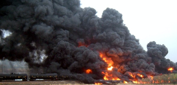 A derailed oil train burns near Heimdal, N.D., Wednesday, forcing the evacuation of nearby homes and farms.
