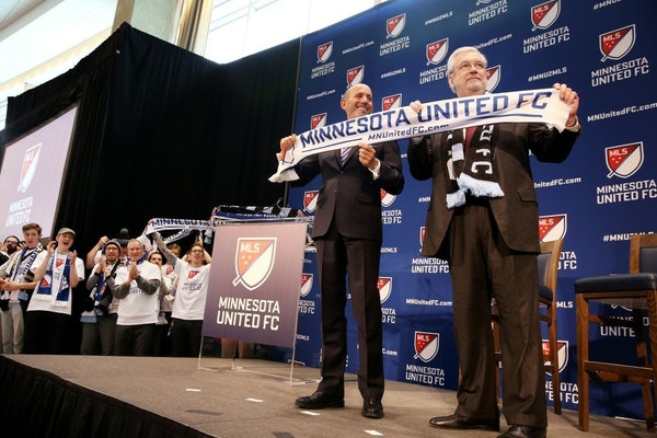 There was great fanfare when Major League Soccer Commissioner Don Garber, left, and Dr. Bill McGuire announce that Minnesota United FC will move to ML