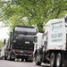 Waste disposal trucks line up on trash pickup day in Bloomington between France Avenue and Normandale Boulevard on Thursday, May 7, 2015.