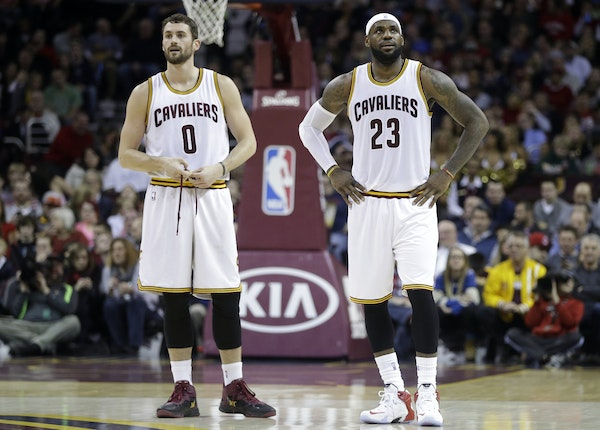 Cleveland Cavaliers' Kevin Love (0) and LeBron James (23) during an NBA basketball game against the Minnesota Timberwolves Tuesday, Dec. 23, 2014, in
