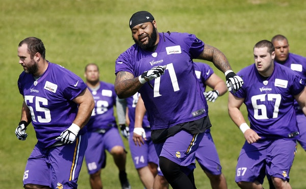 Minnesota Vikings offensive linemen John Sullivan (65) Phil Loadholt (71) and Zac Kerin (67) during the second day of Minicamp at Winter Park.