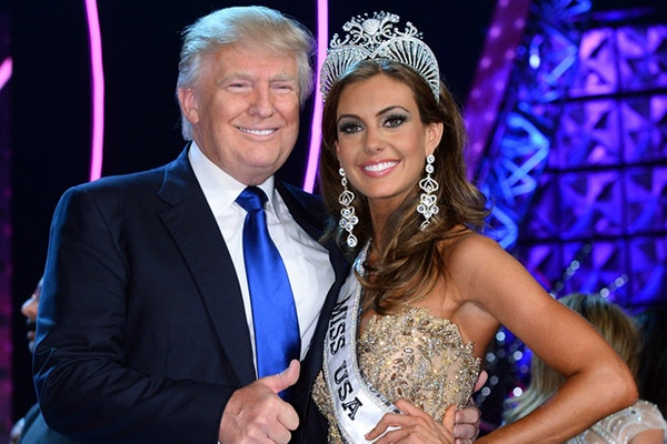 Donald Trump (L) and Miss Connecticut USA Erin Brady pose onstage after Brady won the 2013 Miss USA pageant at PH Live at Planet Hollywood Resort & Ca