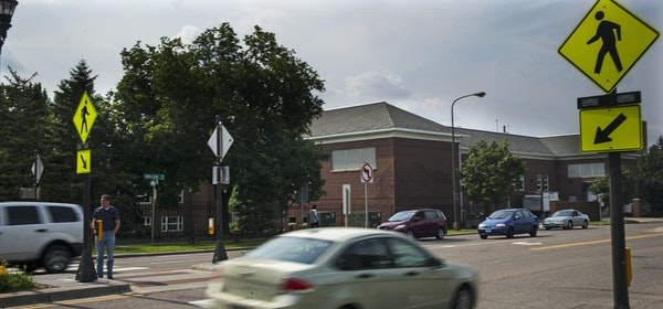 """Walk signs and flashing lights have been installed at the intersection of Lincoln and Snelling avenues in St. Paul — the """"crosswalk from hell."""""""
