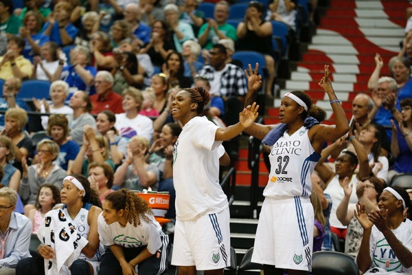 Lynx players Reshanda Gray, left, and Rebekkah Brunson celebrated during the first half of their blowout victory over San Antonio on Sunday.
