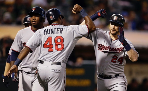 Twins third baseman Trevor Plouffe, right, celebrated his sixth-inning grand slam with Torii Hunter on Friday.