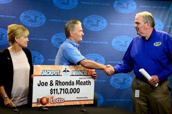 Minnesota Lottery director Ed Van Petten, right, presented Bethel couple Joe and Rhonda Meath as multi-million dollar lotto winners in September.