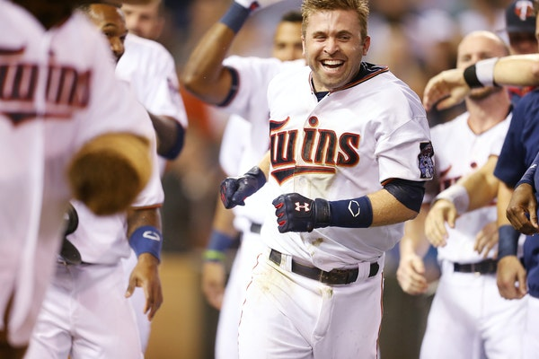 Twins second baseman Brian Dozier was mobbed by teammates after hitting a two-run homer in the 10th inning, giving Minnesota a 4-2 victory over Baltim