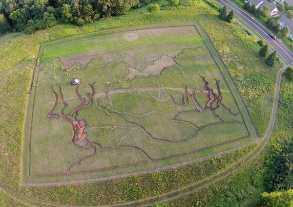 """A bird's-eye view: The outlines of Van Gogh's """"Olive Trees"""" are taking shape in a field in Eagan, as shown in this aerial photo."""