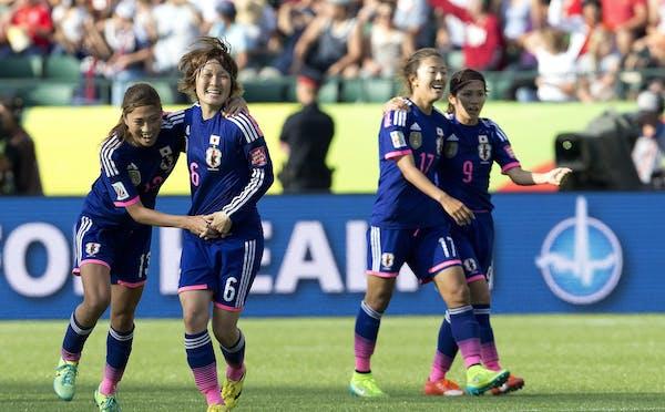 Japan's Rumi Utsugi, Mizuho Sakaguchi, Yuki Ogimi and Nahomi Kawasumi — left to right — celebrated their 2-1 win over England on Wednesday in th