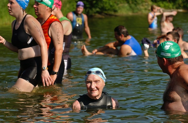 Mary Stroebe and her son, Bruce Stroebe, waded into Lake Nokomis to start the 2006 Life Time Fitness Triathlon.