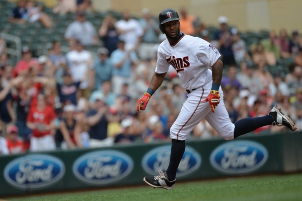 The Twins' Danny Santana raced toward home in the fourth inning on Sunday as he continues to build off his clutch hit on Friday.