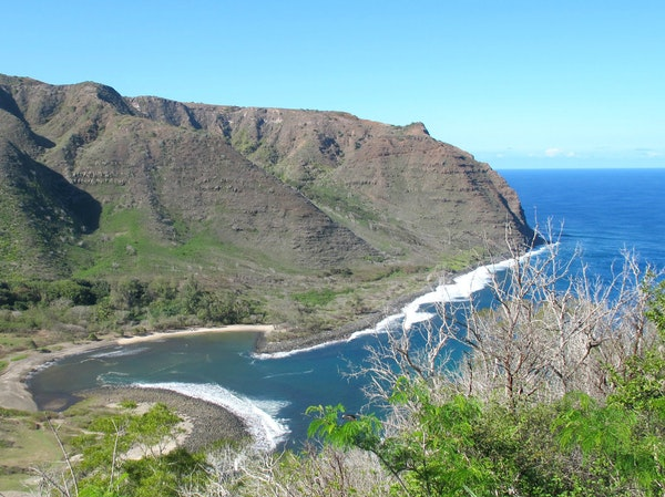 At the end of the road on the island of Molokai is the remote Halawa Valley and its peaceful crescent of beach.