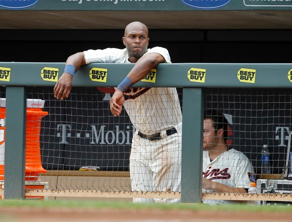 Twins outfielder Torii Hunter, shown hanging over the dugout railing during a June game, said he knows he's got more pop in his bat than he's given cr