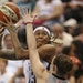 The Lynx' Seimone Augustus looked for a shot over San Antonio's Samantha Logic in the third quarter Sunday.