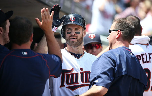 Minnesota Twins first baseman Joe Mauer was greeted by teammates after hitting a solo home run against the Cardinals in June.