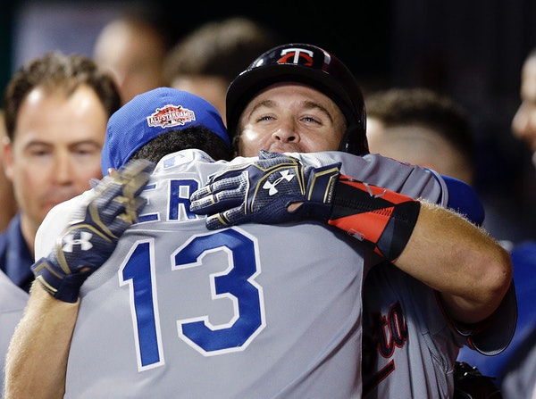 American League's Brian Dozier, of the Minnesota Twins, celebrates with American League's Salvador Perez, of the Kansas City Royals, after hitting a h