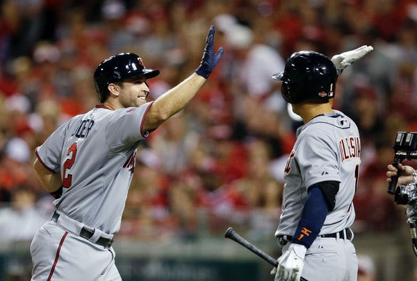 American League's Brian Dozier, of the Minnesota Twins, is congratulated after hitting a home run during the eighth inning of the MLB All-Star basebal