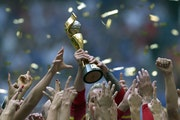 The United States Women's National Team celebrates with the trophy after they defeated Japan 5-2 in the FIFA Women's World Cup soccer championship in
