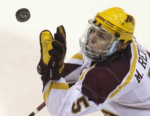 University of Minnesota Gophers defensemen Mike Reilly (5)