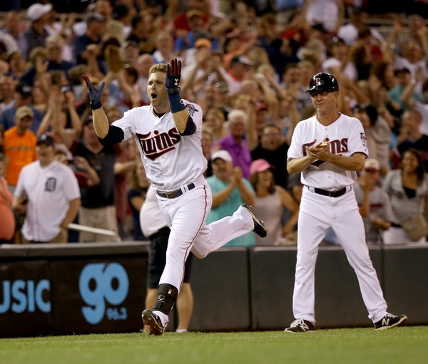 The Twins' Brain Dozier celebrated his walkoff home run rounding third base.