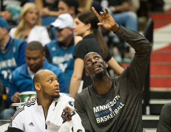 Wolves forward Kevin Garnett, right, chatted with Adreian Payne during a game in February but also met up with Payne and other members of the Wolves'