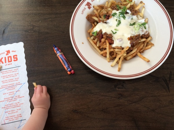 The casual diner atmosphere at Little Goat is perfect for children. There's a kids menu, but don't be surprised if they want to nibble the goat chili
