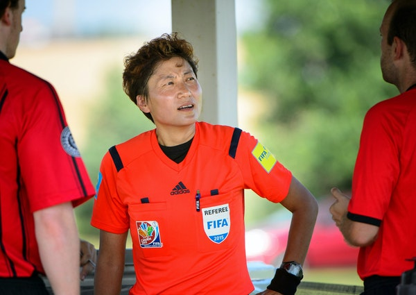 Players quickly recognized Chinese FIFA referee Qin Liang, who refereed at the recently completed Women's World Cup in Canada.