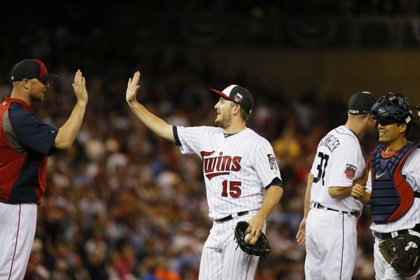Glen Perkins, center, was able to high-five with American League teammates in last year's All-Star Game after he notched the save.