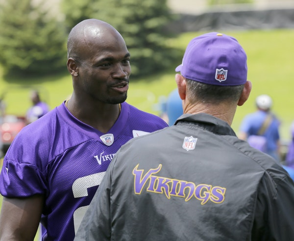 Vikings running back Adrian Peterson and coach Mike Zimmer, right, talked during minicamp last month at Winter Park. Zimmer believes Peterson's pres