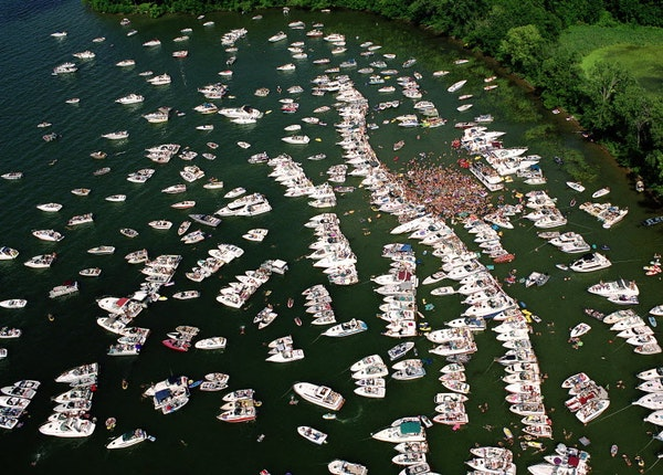 Lake Minnetonka has long been a popular spot for summer boaters, who often congregate in Cruiser's Cove, above.