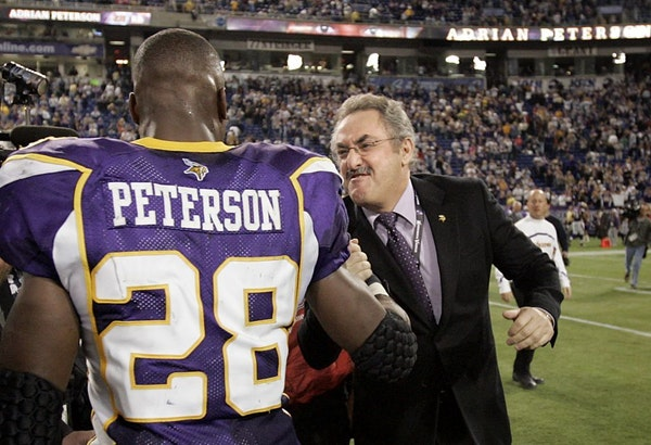 Zygi Wilf and Adrian Peterson in 2013.