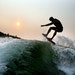Pro wakeboard surfer Chris Banks practices wakeboard surfing on Lake Minnetonka near dawn.