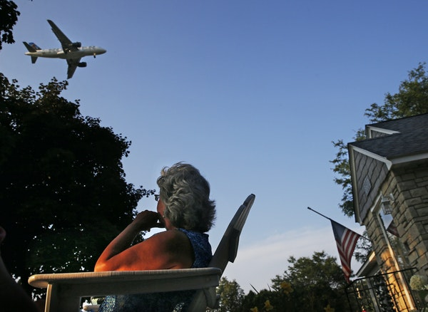 Lori Moen, who has lived in her south Minneapolis home for 23 years, watched a plane approach the airport. Moen and husband, Al, are downsizing and se