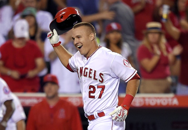 Reigning American League MVP Mike Trout, tossing his helmet after Friday night's walk-off homer to beat the Red Sox, is playing well again for an An