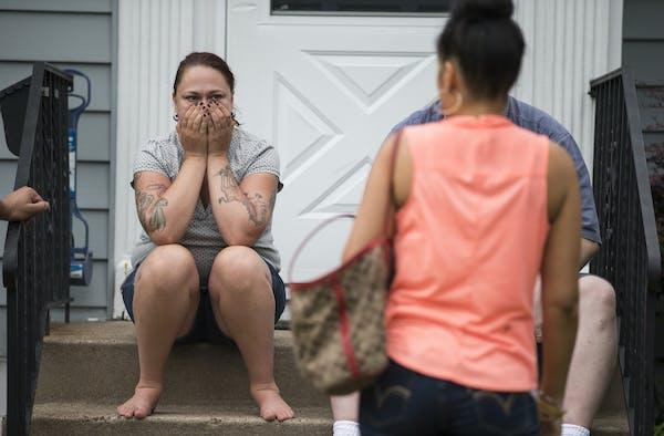Dayna Hudson and other neighbors gathered near 5120 Dupont Av. N., where Susan Spiller's body was discovered Thursday morning.