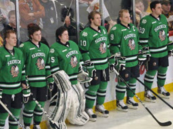"""The University of North Dakota lined up before a hockey game in 2012, the year when the school dropped its """"Fighting Sioux"""" nickname and logo."""