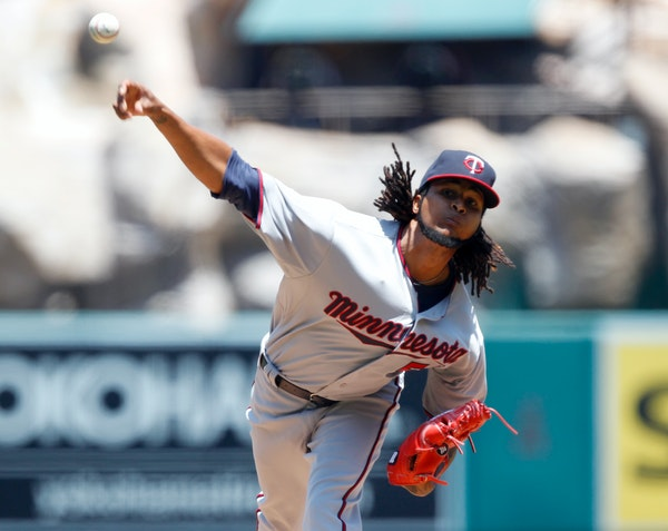 Minnesota Twins starting pitcher Ervin Santana throws against the Los Angeles Angels during the first inning of a baseball game in Anaheim, Calif., Th