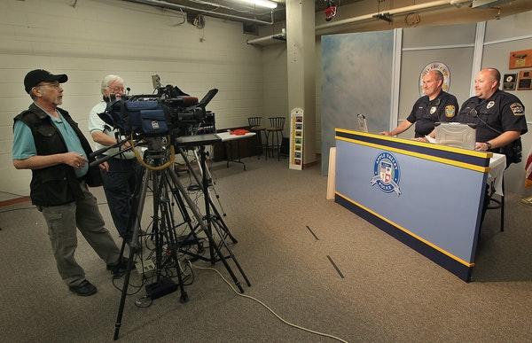 Mark Moore, cable coordinator, left, and Terry Devine, Center, taped a police show with Farmington Police officer Steve Kuyper, left, and Rosemount Po