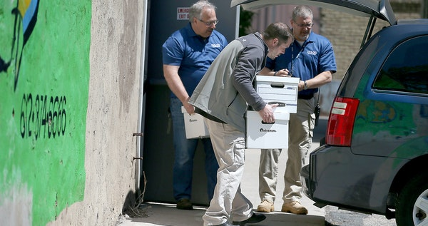 Officials from the DHS and BCA removed boxes and computer equipment from the Salama Child Care Center, Wednesday, May 13, 2015 in Minneapolis, MN.