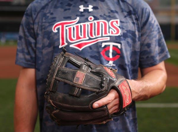Minnesota Twins third baseman Trevor Plouffe with his glove at Target Field.