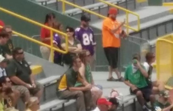 Who's the fan in the Vikings jersey at the Packers' shareholders meeting?