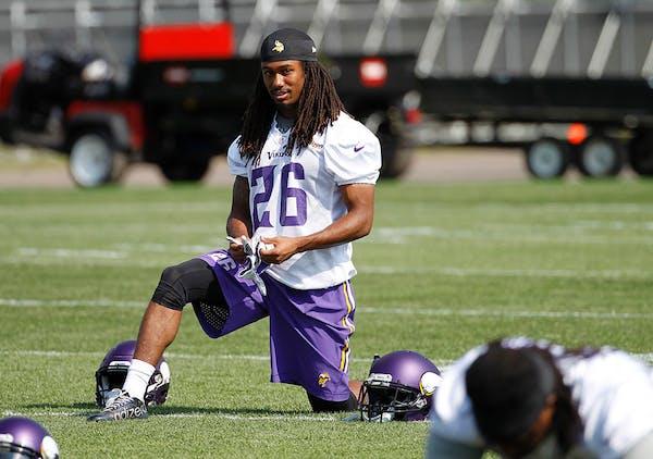 Minnesota Vikings cornerback Trae Waynes (26) stretches during NFL football minicamp