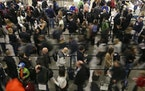 Air travelers waited in line for the TSA security screening at Minneapolis-St. Paul International Airport.