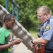 St. Paul Police officer Rob Zink visited in 2015 with Devont'e Ray-Burns, 12, who has autism and other disabilities, outside Ray-Burns' home in St. Pa