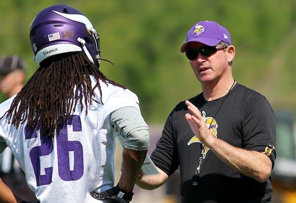Minnesota Vikings head coach Mike Zimmer talks with Trae Waynes