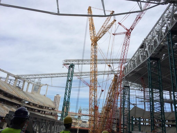Beneath the forest of cranes, the new Vikings stadium is taking shape.