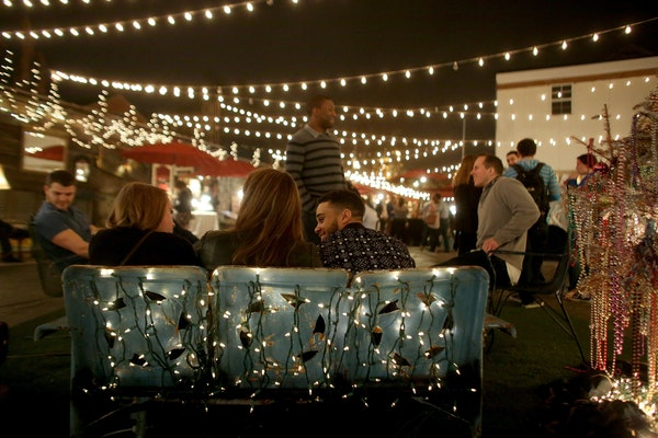 Groups of young people hung out and spent time with each other at Frenchman Art Market in New Orleans.