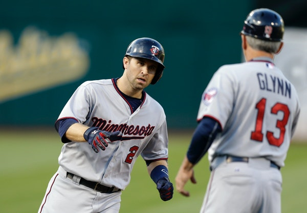 In his first plate appearance since homering in the All-Star Game, the Twins' Brian Dozier connected for a leadoff shot against Oakland to open Friday